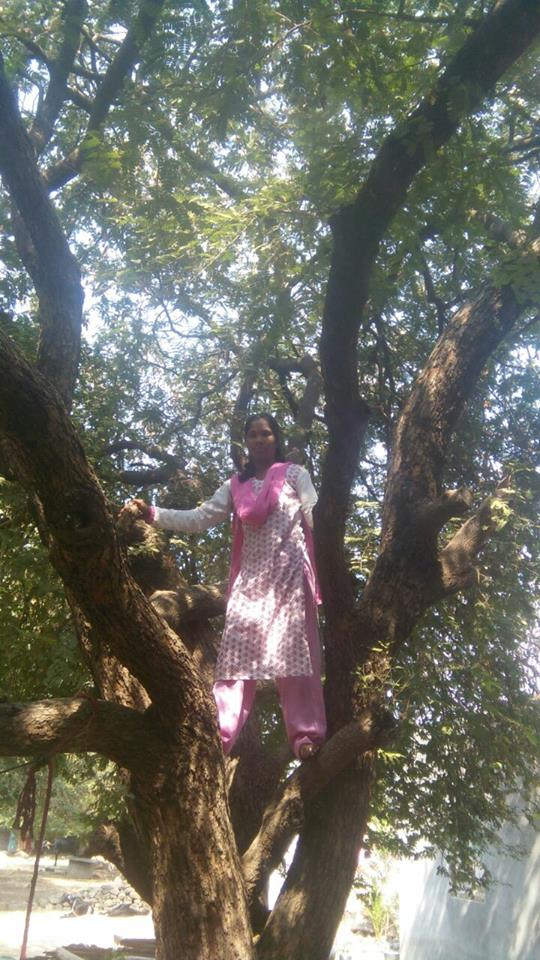 Noor Jahan in one of the tamarind trees she bought for her livelihood